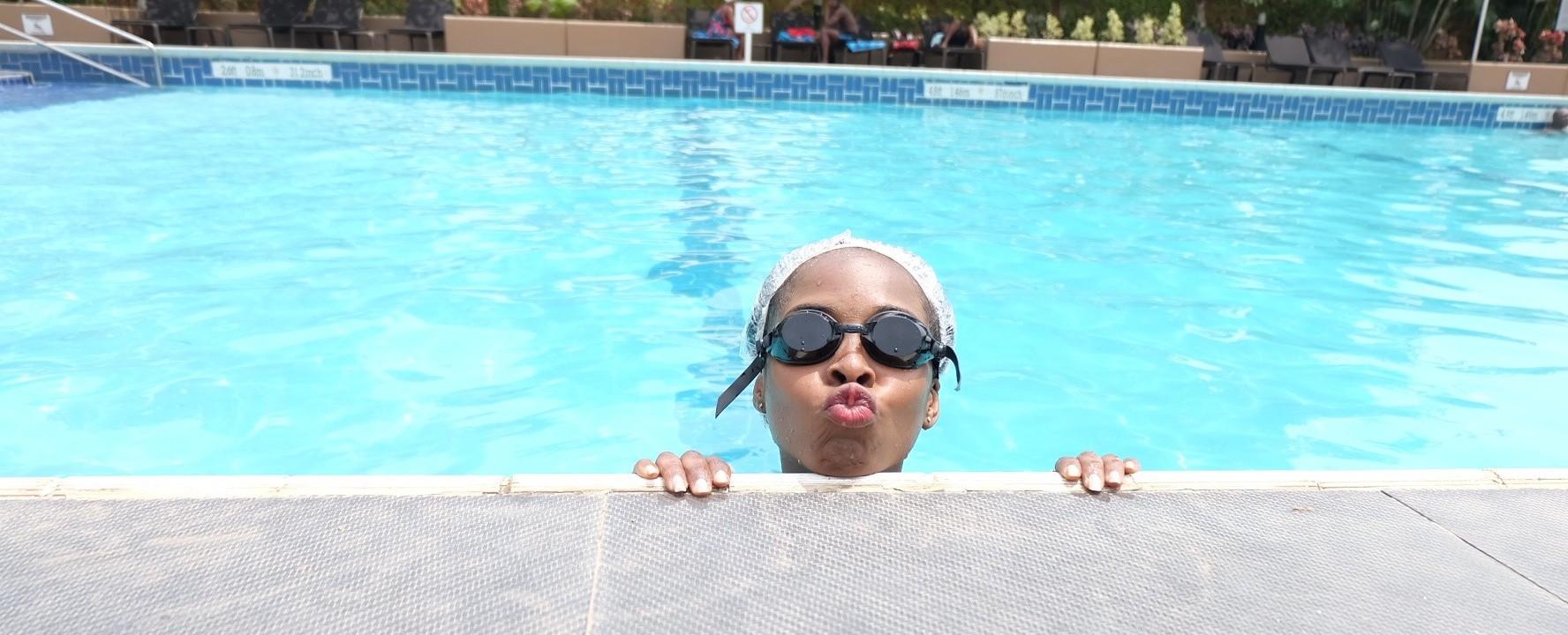 Girl in pool in Abuja