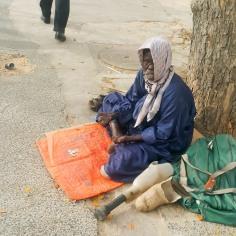 Beggar in Dakar (RedConfidential)