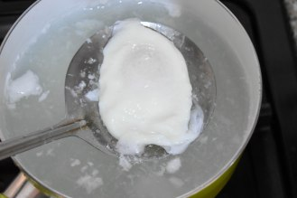 Poached egg out of the boiling water