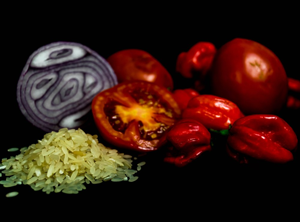 Rice, Sliced tomato and sliced onion, Scottish bonnet peppers isolated on black background