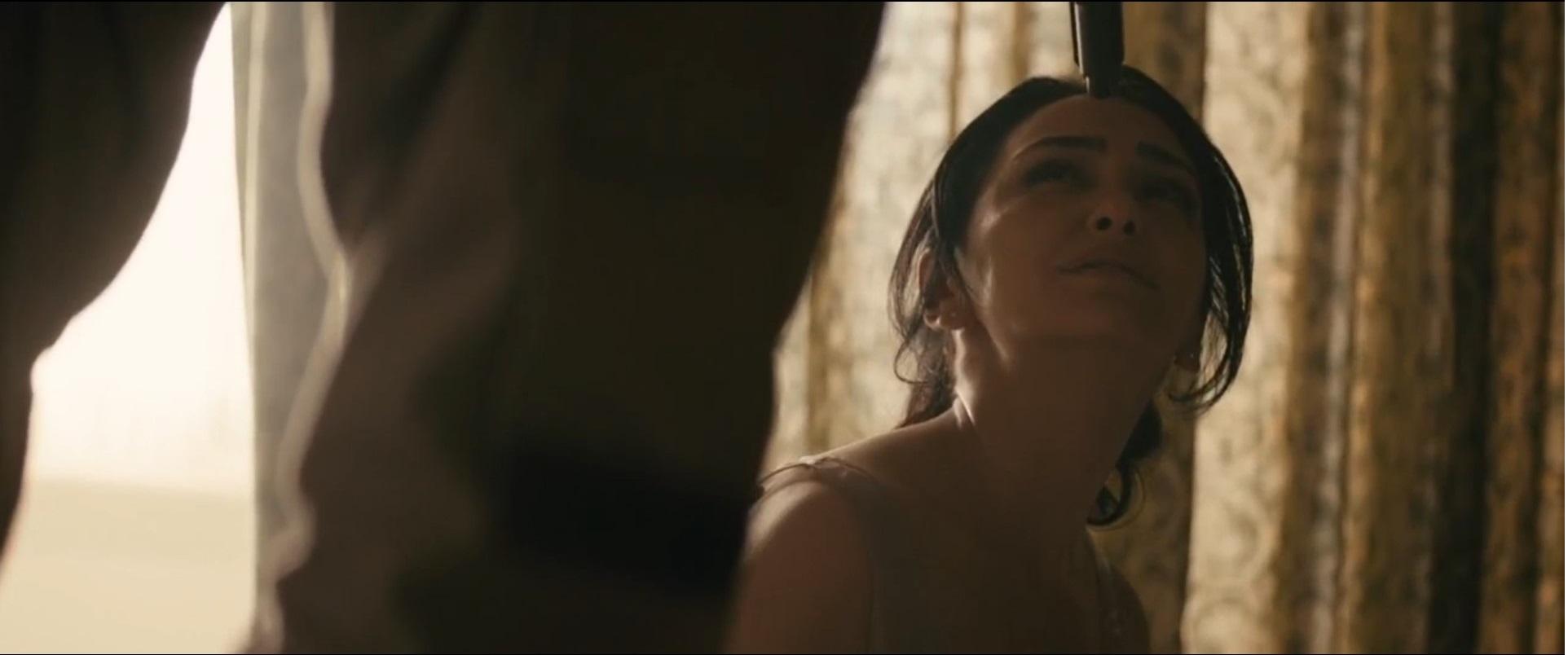 Zahra (Nazanin Boniadi) performing Salat as the terrorist holds his gun to her head in Hotel Mumbai
